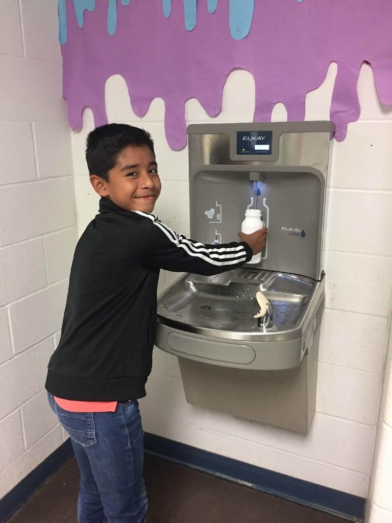 Wickes Elementary student, Raul, enjoying our new water bottle filling station!
